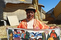 Ana presenting one of her tapestries, Uros Islands